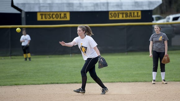 Ashton Glance lobs the ball to second base during softball practice for Tuscola on Thursday.