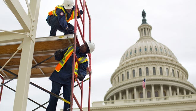 In this Dec. 8, 2016, file photo, construction continues for the Inauguration and swearing-in ceremonies for President-elect Donald Trump on the Capitol steps in Washington.