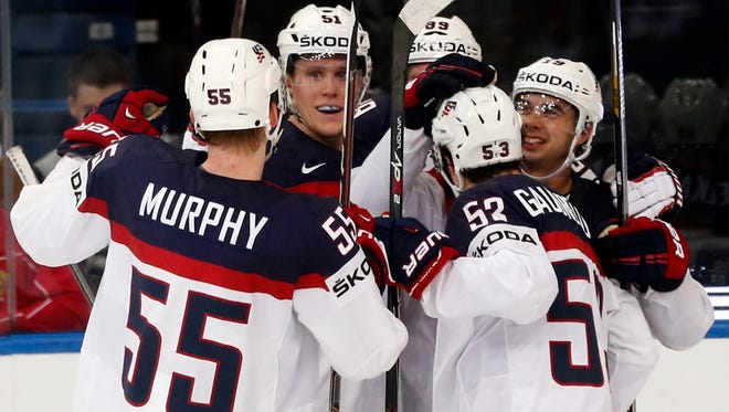 United States players celebrate a goal during the Group B preliminary round match against Germany at the Ice Hockey World Championship in Minsk, Belarus.
