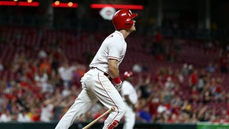 Cincinnati Reds second baseman Scooter Gennett (3) reacts to hitting a grand slam home run against the Pittsburgh Pirates in the fifth inning at Great American Ball Park.
