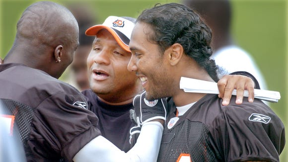 2004.0810.05--Bengals--Cincinnati Bengals wide receivers coach  Hue Jackson talks with receivers Chad Johnson and T.J. Houshmandzadeh during training camp in Rawlings Stadium at Georgetown (KY) College Tuesday afternoon, August 10, 2004.