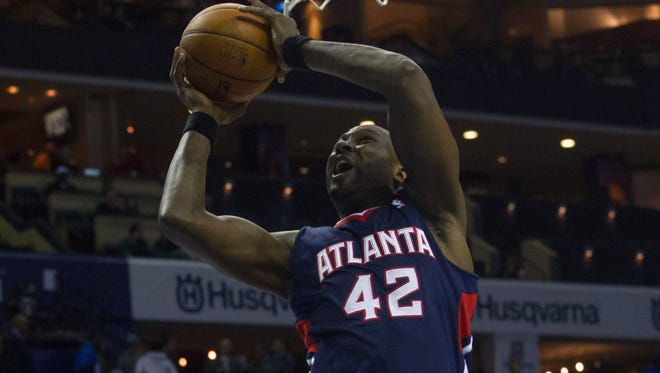 Peekskill native and Atlanta's Elton Brand goes up for a shot in the first half against Charlotte on Monday.