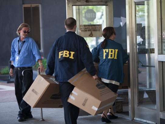 FBI agents bring in more boxes to the City-County BuildingÃ?s 20th floor offices of the Indianapolis Department of Metropolitan Development investigating the Indy Land Bank Tuesday, May 21, 2013.  Danese Kenon/The Star