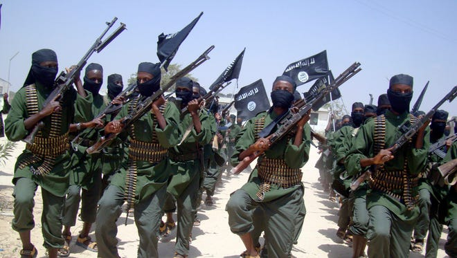 In this Thursday, Feb. 17, 2011 file photo, al-Shabab fighters march with their weapons during military exercises on the outskirts of Mogadishu, Somalia. A U.S. special operations soldier was killed and four injured in an attack by al-Shabab extremists in Somalia's Jubaland on June 8,2018.