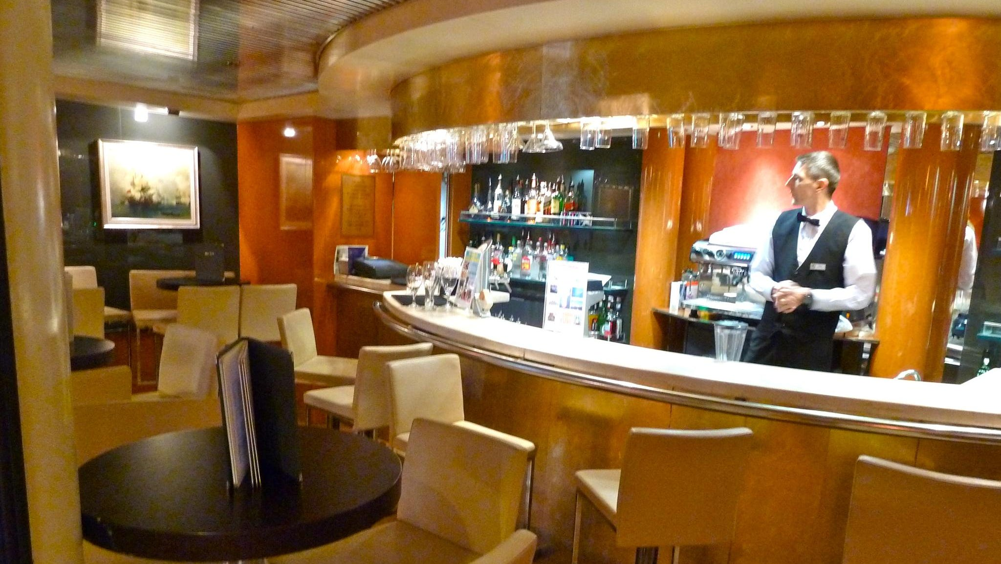 On the starboard side of the Columbus Lounge, there is an intimate bar area.
