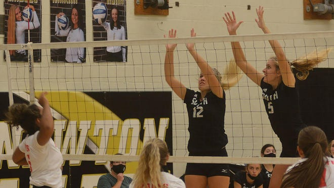Salina South seniors Evie Barth and Lauren Davison put up a block against Maize Tuesday in Newton. South plays Saturday at the Newton Invitational.