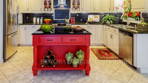 The old island was replaced with red cabinetry.