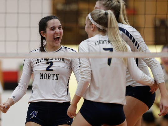 Appleton North's Katie Hoeffner (2) celebrates winning a point against Neenah during their volleyball match Tuesday, October 3, 2017, in Neenah, Wis.