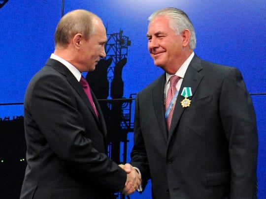 Russian President Vladimir Putin presents ExxonMobil