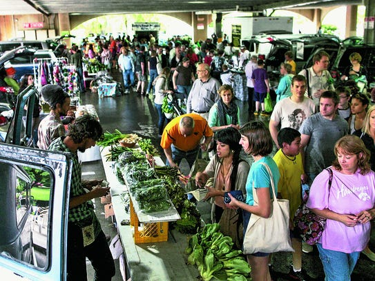 Customers and vendors are seen at the season's first