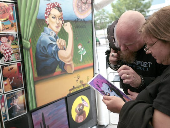 Tom and Jamie Roling of Tiffin look at a Marilyn Monroe
