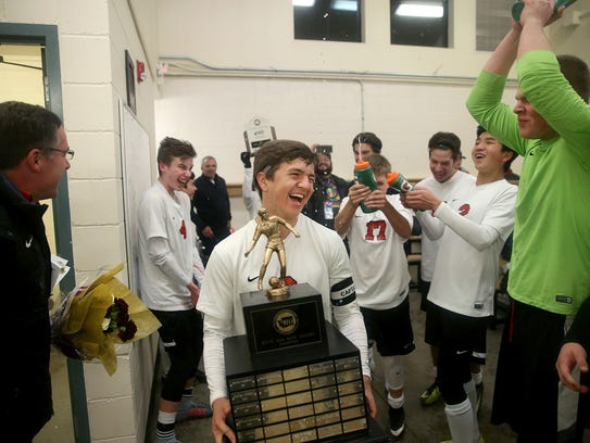 Crosspoint soccer player Aydan Laurion gets sprayed