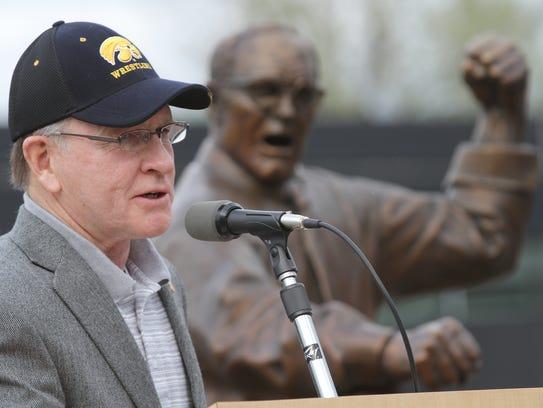 Dan Gable speaks during his statue unveiling at Carver-Hawkeye