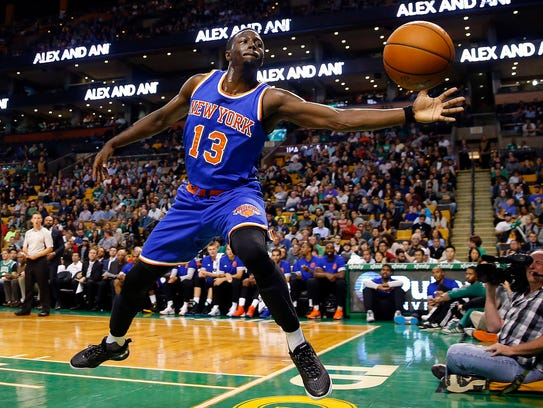 New York Knicks guard Jerian Grant tries to keep the