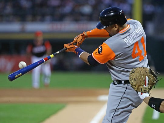 The Tigers' Victor Martinez hits a single in the 2nd