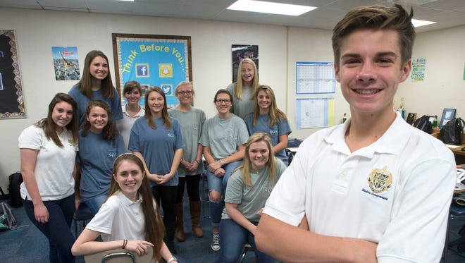 Blake Barclay, right, and members of the Gulf Breeze High School Student Government Assoc. will hold a fundraiser this weekend. Barclay is helping to organize the weekend event to benefit the Ronald McDonald House.