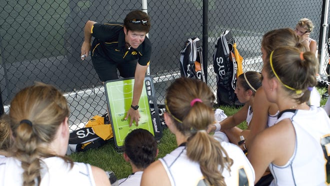 In this undated file photo provided by the University of Iowa athletics department, former Iowa field hockey coach Tracey Griesbaum works on a play with the team.