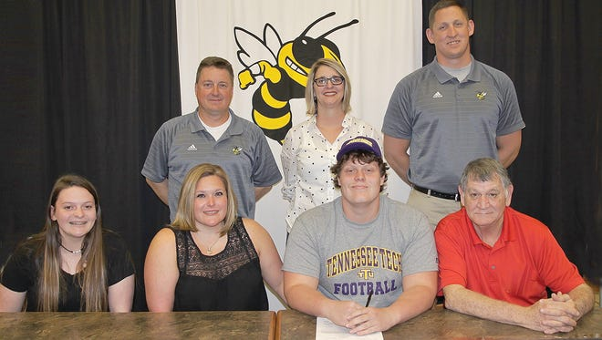 Fairview High's McKenzie Viau signs to play football with Tennessee Tech. Pictured (front row) sister Cailie Viau, mother Cari Davidson, McKenzie Viau, grandfather Guy Davidson; (back row) - FHS Head Football Coach Chris Hughes, Principal Dr. Juli Oyer, and Coach Michael Jackson.