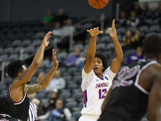 University of Evansville's Dru Smith (12) shoots as the University of Evansville play North Carolina Central for Kids Day at the Evansville Ford Center Monday, November 13, 2017.