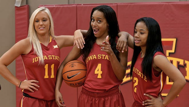 #4 Nikki Moody, center, played it up for the camera as she posed with #11 Jadda Buckley, left, and #2 Nakiah Bell at the Iowa State women's basketball media day at the Sukup Basketball Facility in Ames on Thursday Oct. 2, 2014.