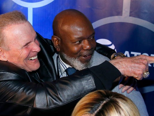 Former Dallas Cowboys football player Emmitt Smith, right, and former director of operations Bruce Mays react on the Blue Carpet during the 25th Anniversary of Super Bowl XXVII at Gilley's in Dallas, Saturday, Feb. 25, 2017. (Tom Fox/The Dallas Morning News via AP)