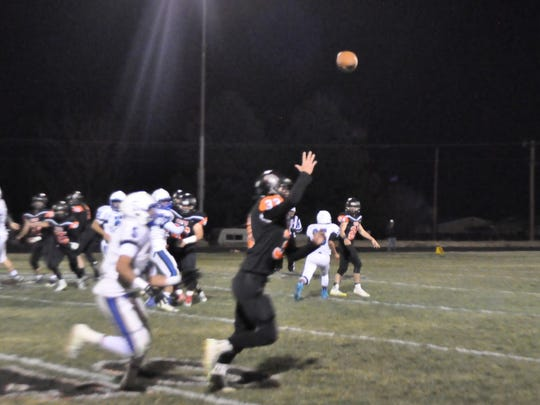 Price Bowen pitches the ball to Devan Wooddell for