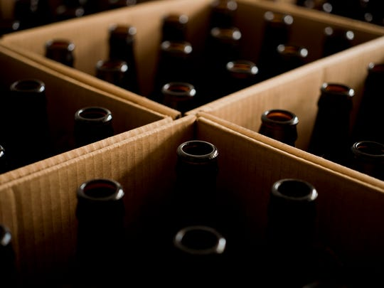 Bottles wait for beer at Simple Roots, run out of a garage-turned-brewery at the home of Dan Ukolowicz and Kara Pawlusiak in Burlington.