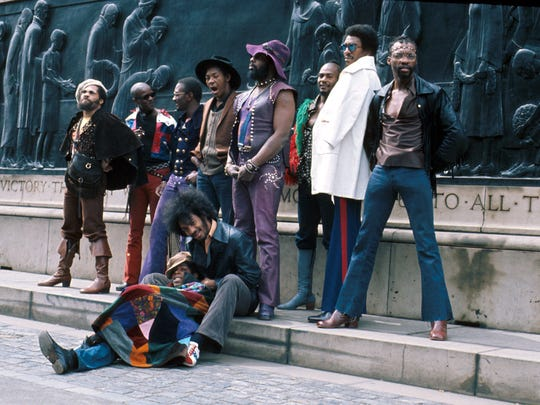 Parliament-Funkadelic in 1971 in Liverpool: Pictured from left to right are vocalist Fuzzy Haskins, guitarist Tawl Ross, keyboardist Bernie Worrell, drummer Tiki Fulwood, vocalist Grady Thomas, founder George Clinton, vocalist Ray Davis, vocalist Calvin Simon and, seated, guitarist Eddie Hazel and bassist Billy Nelson.