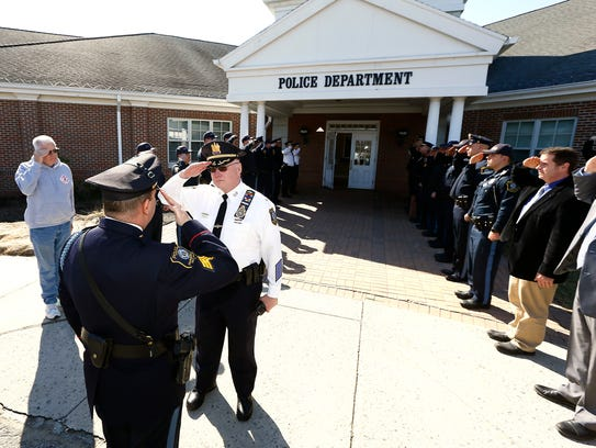Retiring Parsippany Police Chief Paul Philipps salutes