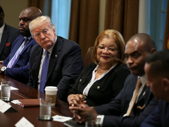 President Donald Trump listens during a meeting with