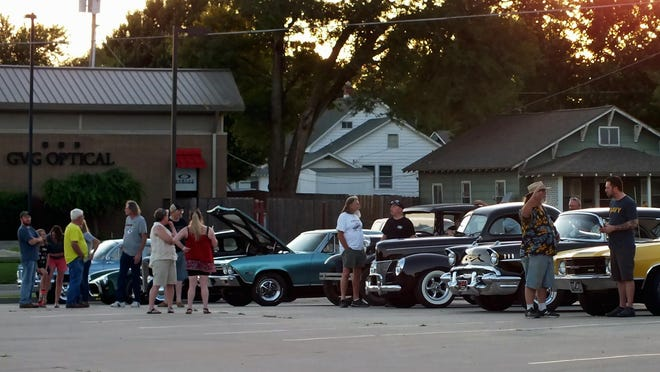 Many attendees meet and chat in front of Jimmy's Egg earlier this month in El Dorado, Kansas. The meetup lasted from 7 p.m. to sunset on a Friday evening.