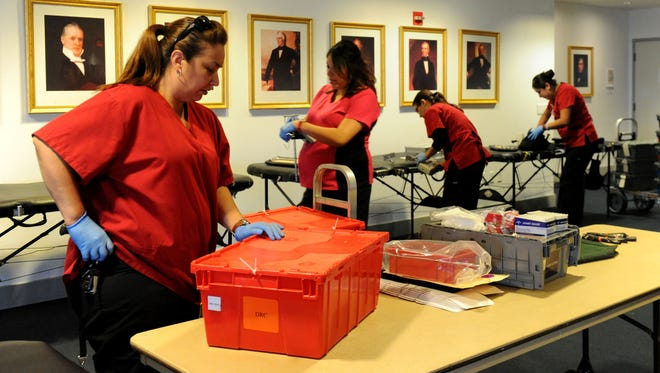 Technician Jenny Zamora prepares for the American Red Cross blood drive at the Ronald Reagan Presidential Library and Museum in Simi Valley early this summer. A number of donation drives are planned this month in Ventura County to address a shortage of blood.
