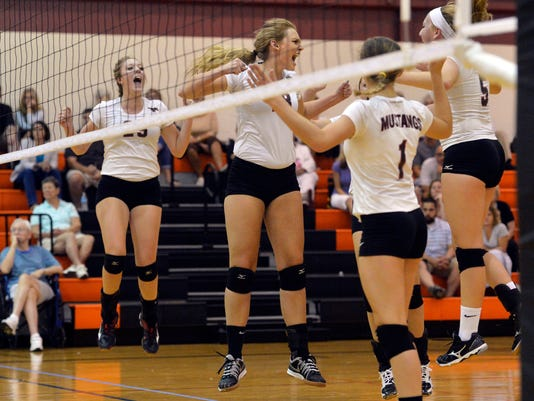 South Western players celebrate a point in the second game of their girls volleyball match on Thursday at Central York High School. The Mustangs fell to the Panthers 3-0 (25-14, 25-23, 27-25).