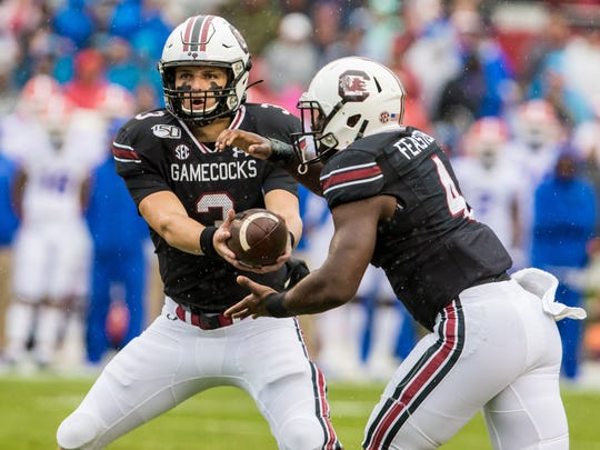 Oct 19, 2019; Columbia, SC, USA; South Carolina Gamecocks quarterback Ryan Hilinski (3) hands off to South Carolina Gamecocks running back Tavien Feaster (4) at Williams-Brice Stadium. Mandatory Credit: Jeff Blake-USA TODAY Sports