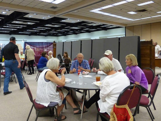 Shoppers take a break for lunch at the antique show.