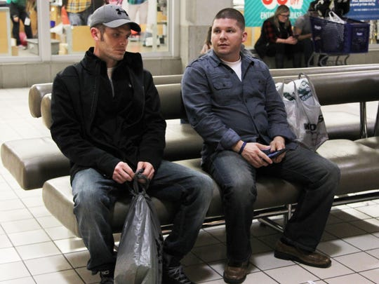 Brothers Ryan Markley, left, and Justin Markley sit