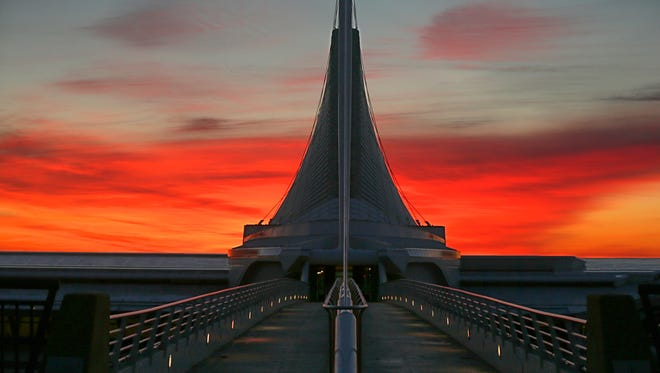 The sun rises over the Milwaukee Art Museum Tuesday morning, March 21, 2017.