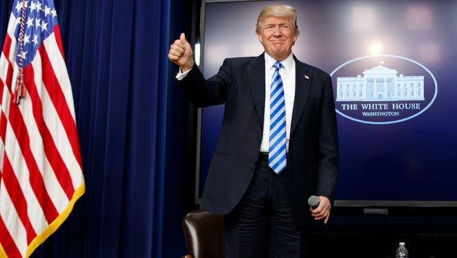 President Donald Trump gives a thumbs-up as he arrives for a town hall with business leaders in the South Court Auditorium on the White House complex in Washington, Tuesday, April 4, 2017.