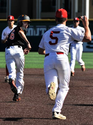 Burkburnett's Andrew Hawkins watches Sweetwater's Mason Maxwell as Hawkins becomes trapped in a rundown between second and third base Thursday at Abilene Christian University. This was Game 1 of their best-of-three series in the first round of the Class 4A state baseball playoffs.