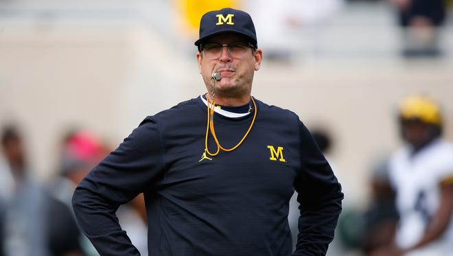 Head coach Jim Harbaugh of the Michigan Wolverines looks on during warm ups prior to playing the Michigan State Spartans at Spartan Stadium on October 29, 2016 in East Lansing.
