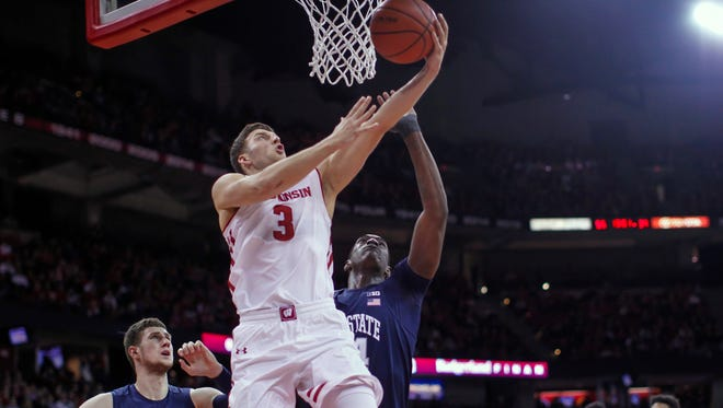 Wisconsin's Zak Showalter shoots against Penn State's Deividas Zemgulis (left) and Julian Moore.