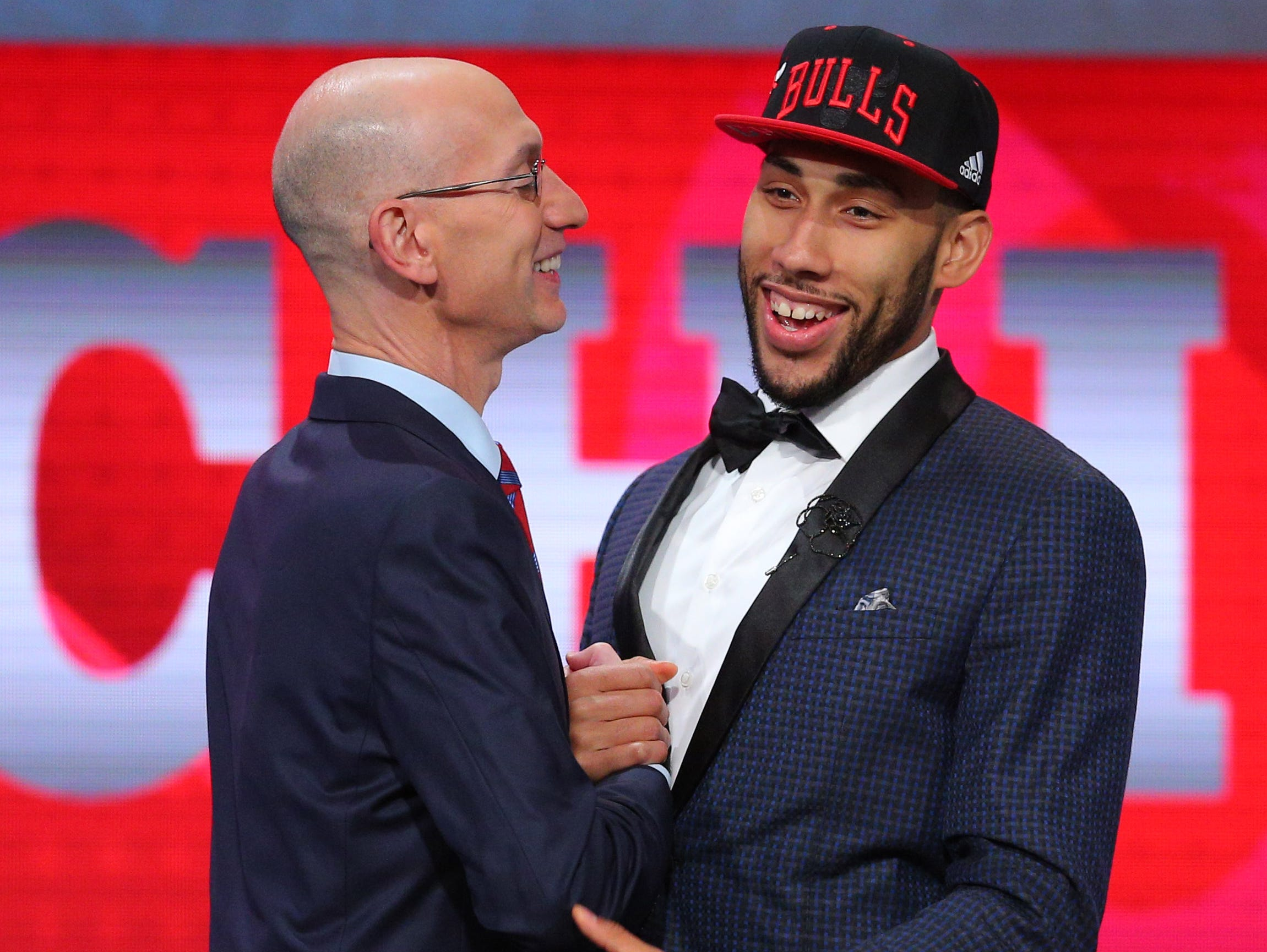 Denzel Valentine greets NBA commissioner Adam Silver after being selected by the Chicago Bulls as the No. 14 overall pick in Thursday's NBA Draft.