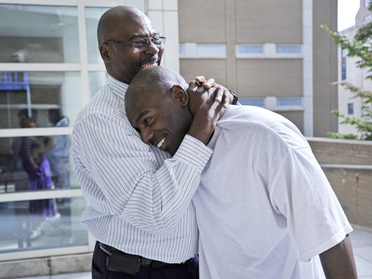 In this file photo Robert Wilcoxson, right, is embraced by his father, Robert Wilcoxson-Bey, after being proclaimed innocent and released from prison after being jailed for 11 years on murder charges.