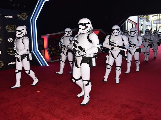 "Stormtroopers march on the red carpet at the world premiere of ""Star Wars: The Force Awakens"" at the TCL Chinese Theatre on Monday in Los Angeles."