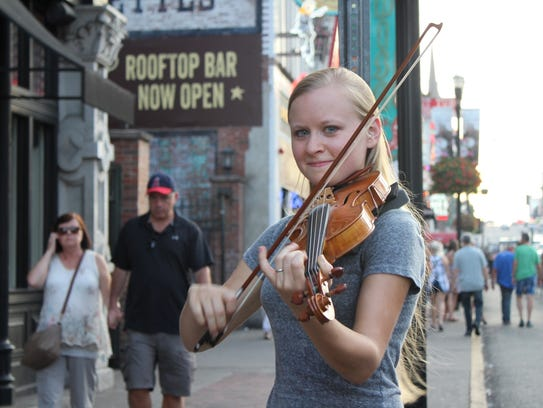 Hillary Klug plays the fiddle on Broadway in Nashville.