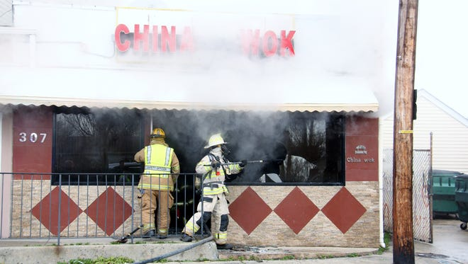 Firefighters bring blaze under control at China Wok in Port Monmouth on Dec. 31, 2015