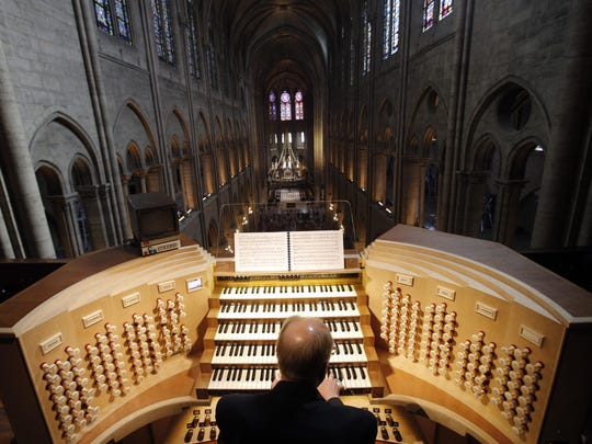 Philippe Lefebvre, 64, plays the organ in 2013 at Notre Dame cathedral in Paris.