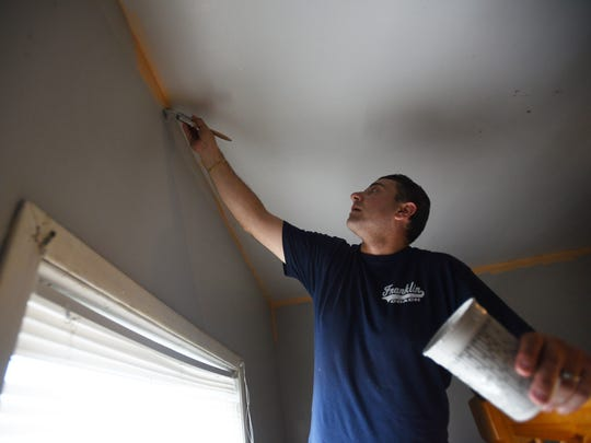"""Volunteer Steve Dipollina paints a wall using natural lead free paints """"Harmony"""" that release no toxic fumes and are asthma friendly,  at Hilltop Heights Shelter in Paterson on May 23rd, 2017. Those volunteers come from Sherwin Williams, Rebuilding Together North Jersey and St. Joseph's Regional Medical Center,,"""