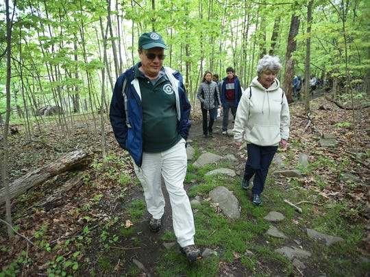 Historical interpreter Eric Nelsen (L) leads participants including, Maureen Graham(R) of Cresskill in an annual tradition of a special Mother's Day Hike along the summit of the Palisades Interstate Park in Alpine on 05/13/18.