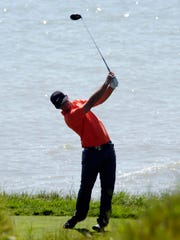 A golfer swings at Whistling Straits during the PGA Championships Tuesday August 11, 2015 near Haven.